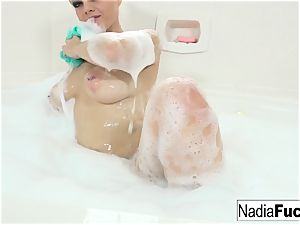 yam-sized tit Nadia milky jerks in the bathtub