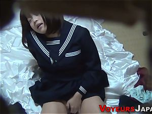 Uniformed asian stunner rubs