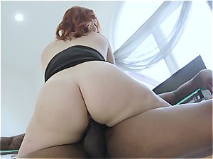 fat caboose red-haired gets a deep ebony dicking at work