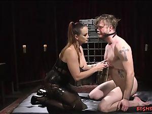 dominatrix likes to poke Her sub With strap dildo