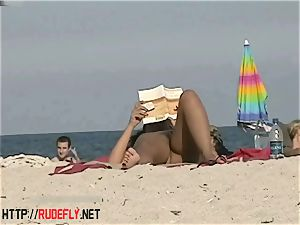 torrid babes filmed lounging on a naturist beach