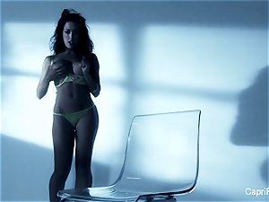 huge-boobed brunette Capri Cavanni works her wet slit