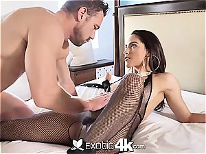 Latina Adrian Hush gets roped onto the bed in nothing but a fishnet