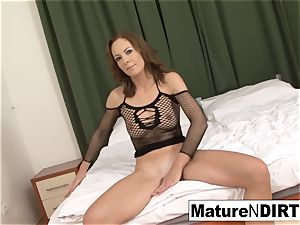 brown-haired milf jerks before taking a big black cock