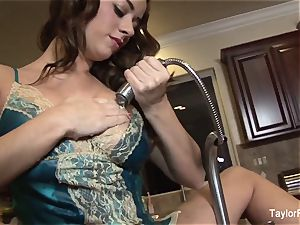 Taylor Vixen plays with her coochie in the kitchen submerge